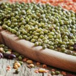 Green lentils on a vintage wooden background, mixed beans, selective focus